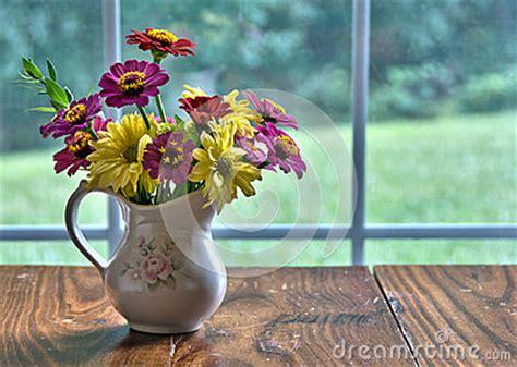 vase  freshly cut flowers royalty  stock