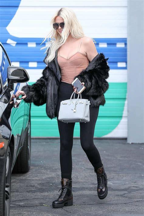 khloe kardashian leaves  studio wearing  pink top