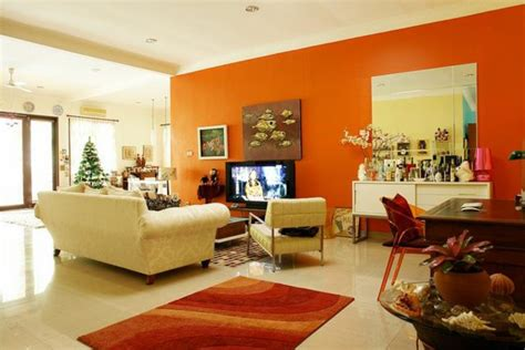 living room with orange walls walls painting paint ideas for orange wall decoration fresh design pedia