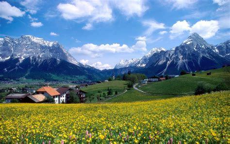 landscape spring mountain village  snow mountains