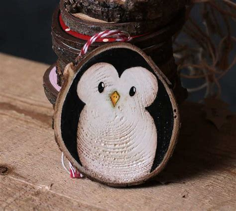 penguin hand painted wood slice ornament by our backyard studio in mill creek wa the weed patch