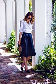 White Pleated Skirt and Blouse