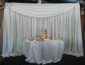 cake monograms draped backdrop for wedding cake table arrowhead dj and