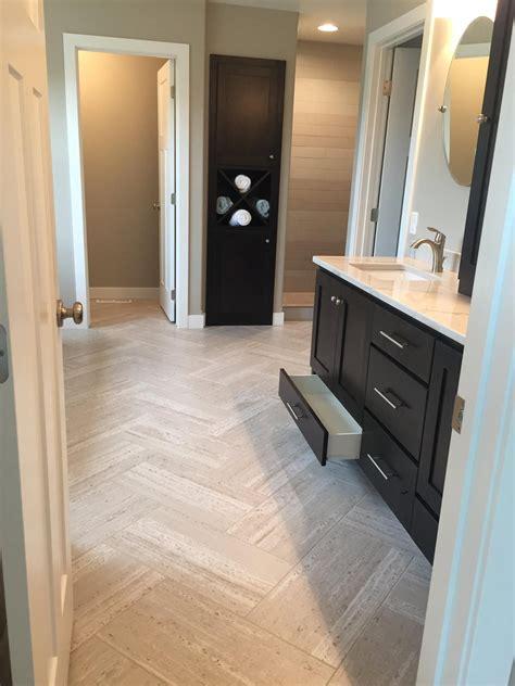 vinyl tile laid  herringbone pattern tile