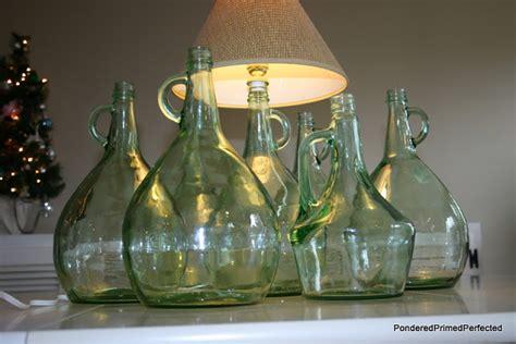 hometalk turning thrift store wine bottles  lamps