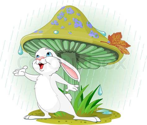 cute rabbit wearing rain gear  mushroom stock