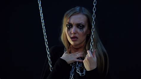 evil zombie girl  black tears  cut throat holds