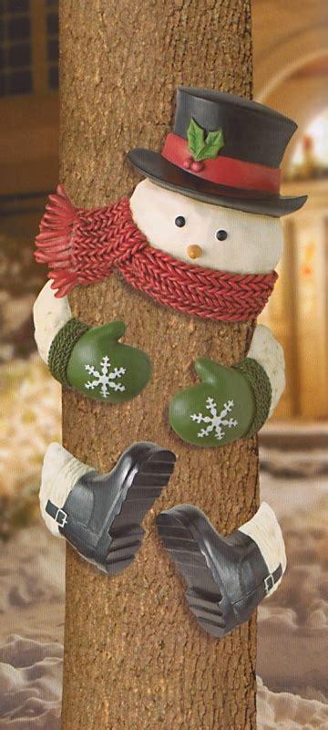 snowman  top hat outdoor tree hugger christmas