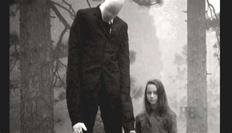 """What Is """"slender Man"""" Whose Face Is Slippery Black Suits And Whose Tentacles Are Stretched From"""