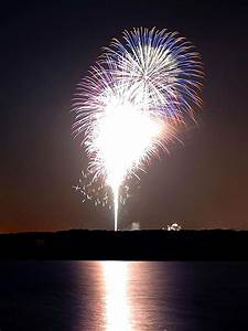File:Fireworks at night over river.jpg - Wikimedia Commons