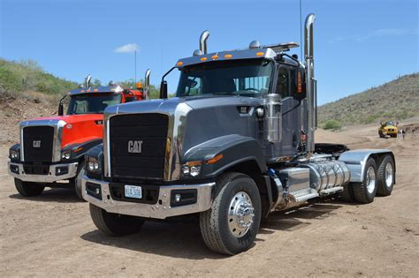 new truck models caterpillar unveils two new truck models for its