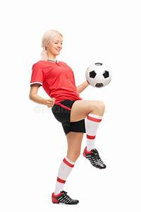 Young Female Soccer Player Juggling A Ball Stock Photo ...