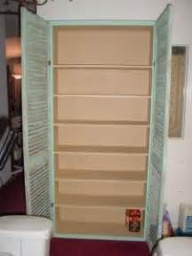 doors on shelves in basement to keep out dust bookshelf