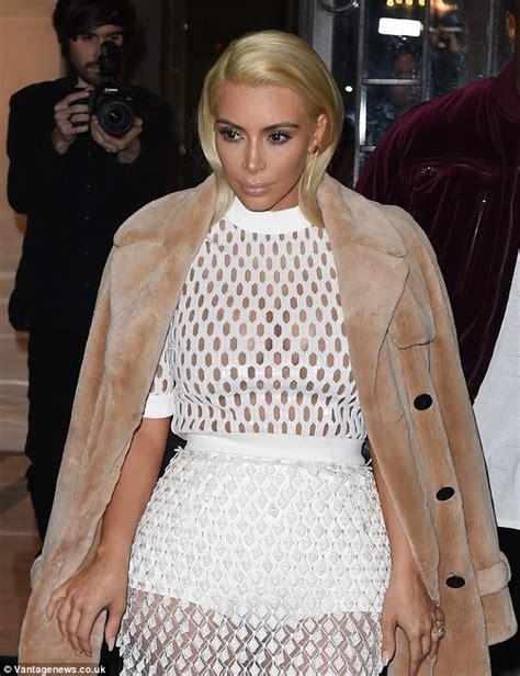 Kim Kardashian leaves little to the imagination as she ...