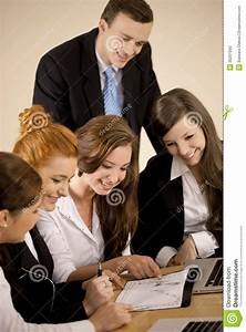 Group Of People Analyzing Diagram Stock Photo