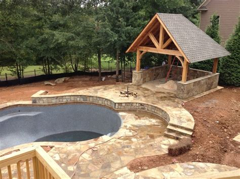 luxury house plans with pools swimming pool cabana rustic patio atlanta by