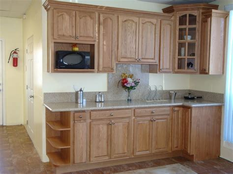 Small Brown Wooden Kitchen Cabinet With Shelves And