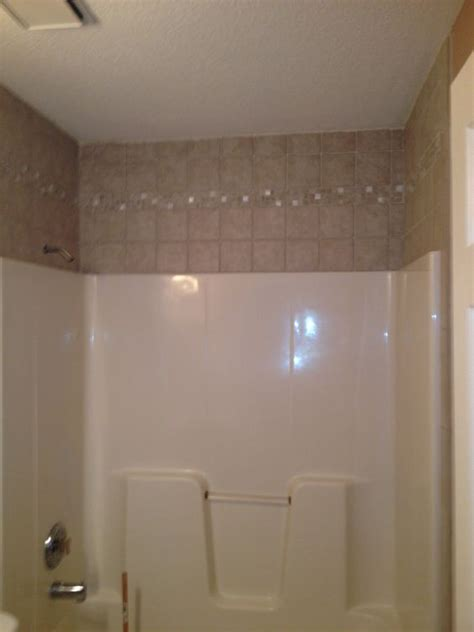 tile around the the fiberglass tub guest my bathroom