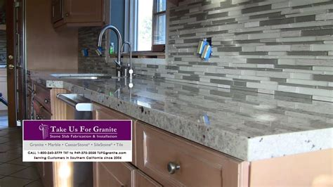 colonial white granite countertops with soho silver stack