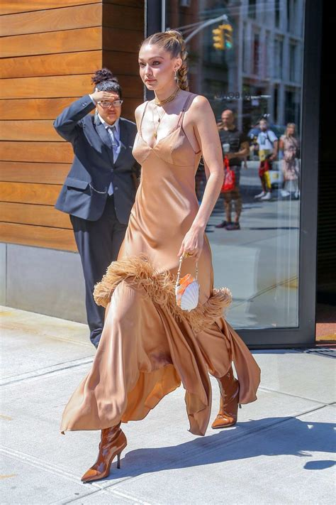 gigi hadid looks elegant in a feathered gown as she heads ...