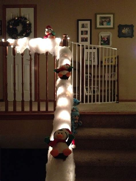 winter  penguins sliding   twinkling snow covered banister christmas decorations
