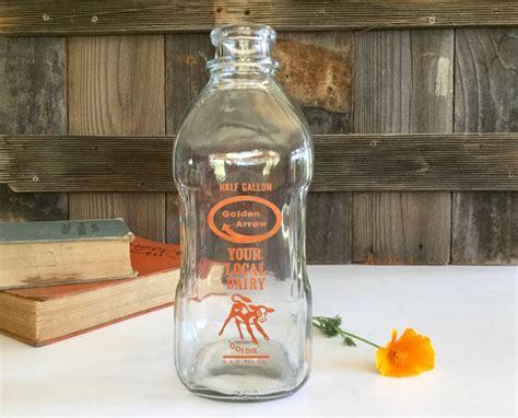 vintage golden arrow  gallon milk bottle  goldie