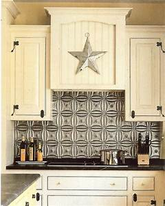 The steampunk home tin backsplashes for Tin ceiling tiles backsplash