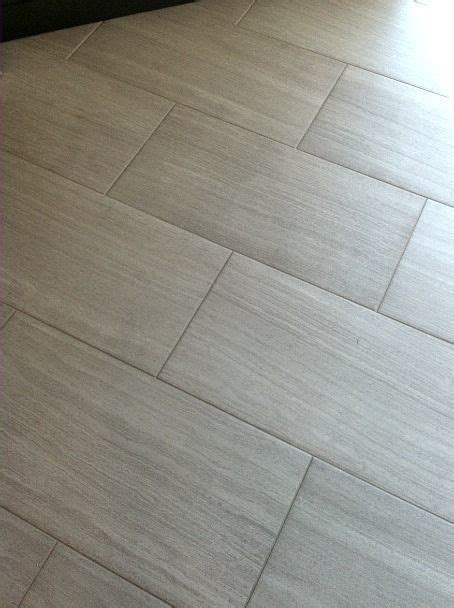 Mitte Gray Tile Grout Color by Florim Stratos Avorio 12x24 Porcelain Tile Master Bathroom