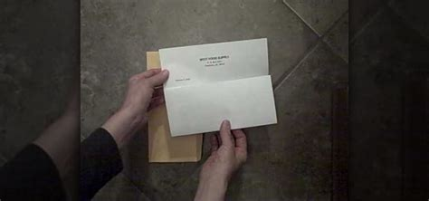 how to properly fold a letter and place it into an