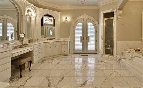 master bathroom suite calcutta gold marble countertops
