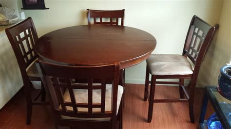 bar height dining room table and matching 4 chairs saanich