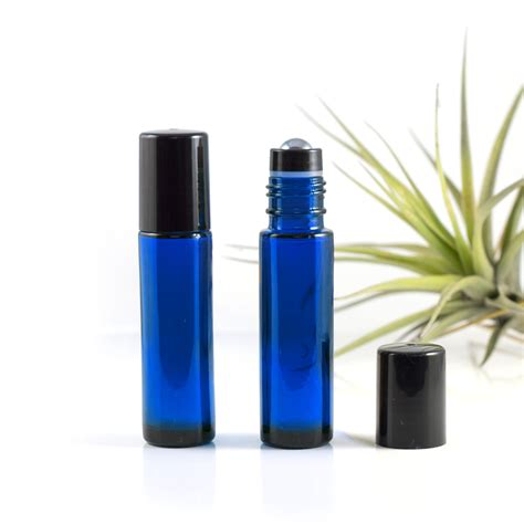 Draw attention to your business by using placeit's label mockups to showcase your latest design or product and leave a lasting impression on your potential. 10ml Blue Glass Roller Bottle with Black Lid & Premium ...
