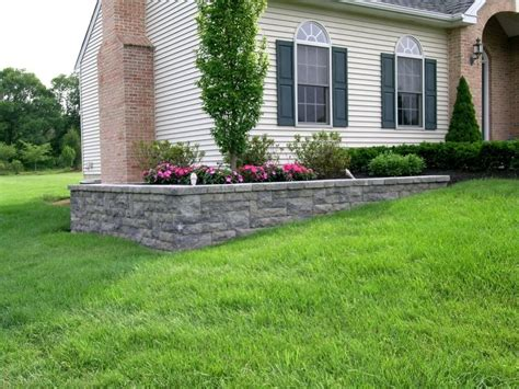 backyard retaining wall a retaining wall is used on this project to level the planting bed of this otherweise sloping