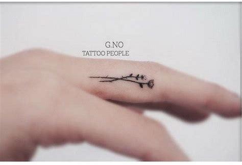 beautiful finger tattoo  women tiny flower tattoos