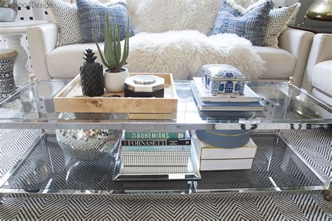 A coffee table is always the center of attention in the living room area. How to style a two-tier coffee table | Cuckoo4Design