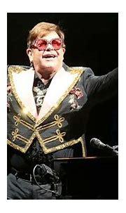 Elton John hosts charity concert with Mariah Carey ...