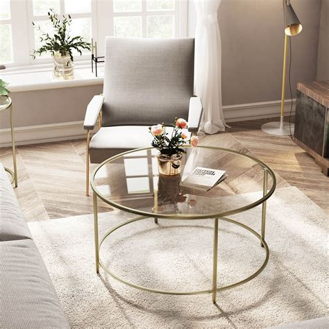 This coffee table features a durable and fashionable glass top in a round shape. Round Glass Coffee Table in 2020 | Living room table ...