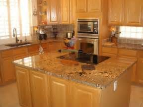2 tier kitchen island this color granite works with oak cabinets and light