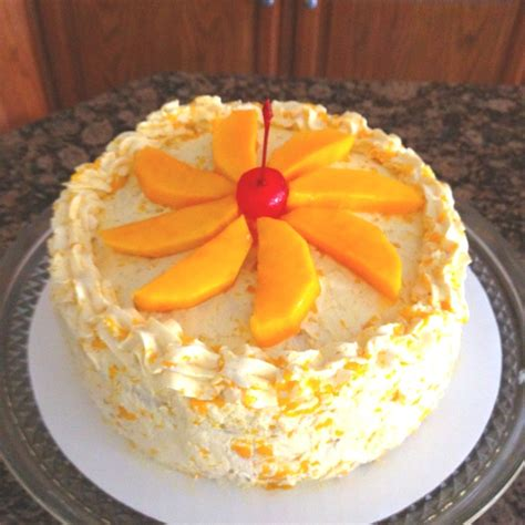 mango cake real mango tidbits slices love  bake