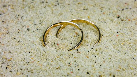 wedding rings  sand  tropical beach stock footage