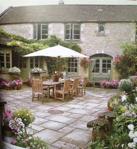 courtyard stone paint color formal cut stone gray pavers blend with the exterior house