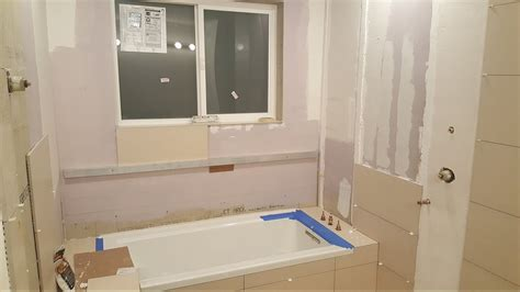grout shower floor tile tub  walls mosaic tile