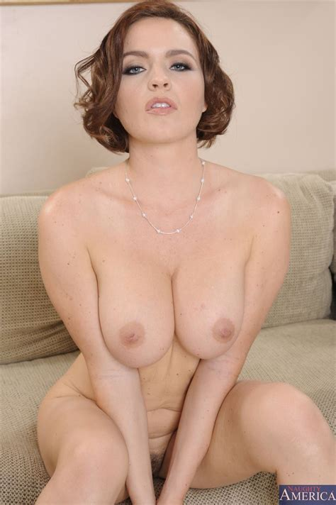 Krissy Lynn has her huge tits fucked on a big couch (Naughty America - 16 Pictures)