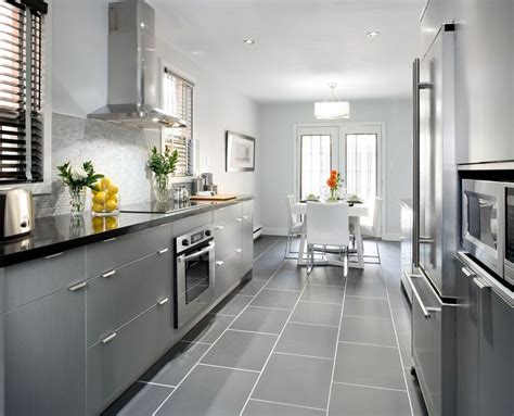 Grey Tiles In Kitchen by Grey Cabinets With Black Counters Wood Floors
