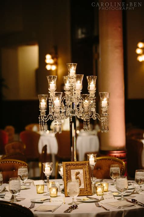 The Medium Centerpieces Will Be Crystal Candelabra With