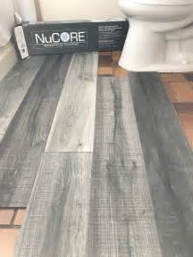 vinyl plank flooring that 39 s waterproof lays right on top of your existing floor this