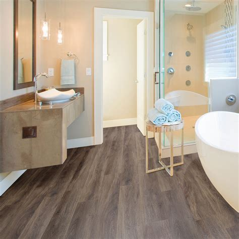 bathroom vinyl flooring b q brown oak effect waterproof luxury vinyl click 17081