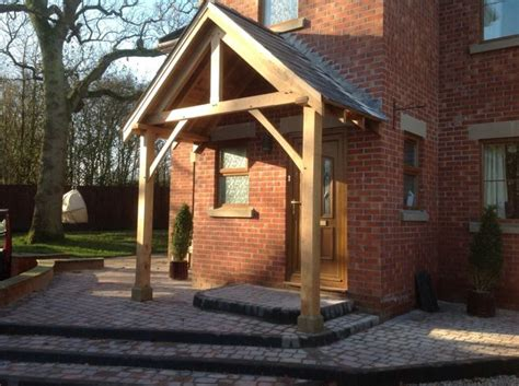 oak porch fitted   staddle stones timber frame