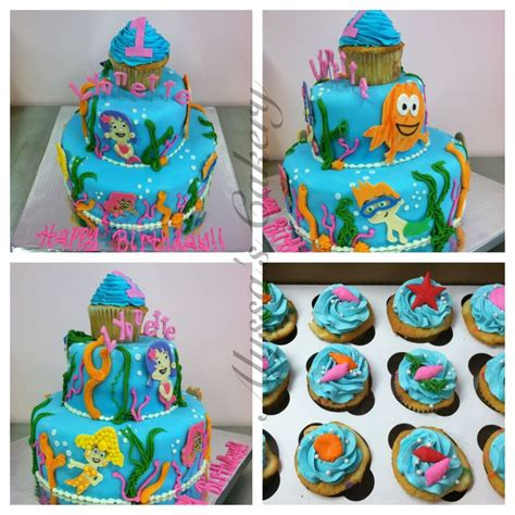 bubble guppies cake 2 tiered with jumbo cupcake topper