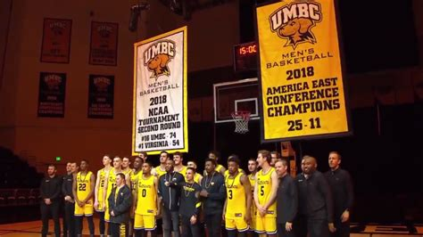 umbc basketball team raises banner commemorating